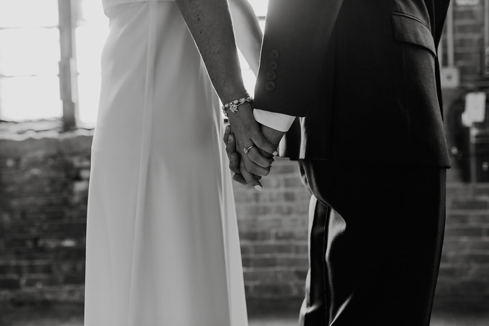 emotional-first-look-with-bride-and-groom-black-and-white-columbus-ohio-wedding-photographer1.jpg