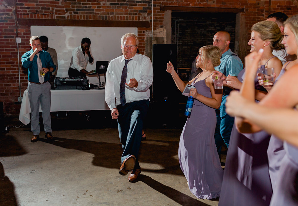 wild-dancing-guests-having-fun-strongwater-reception-columbus-ohio-wedding-photographer1.jpg