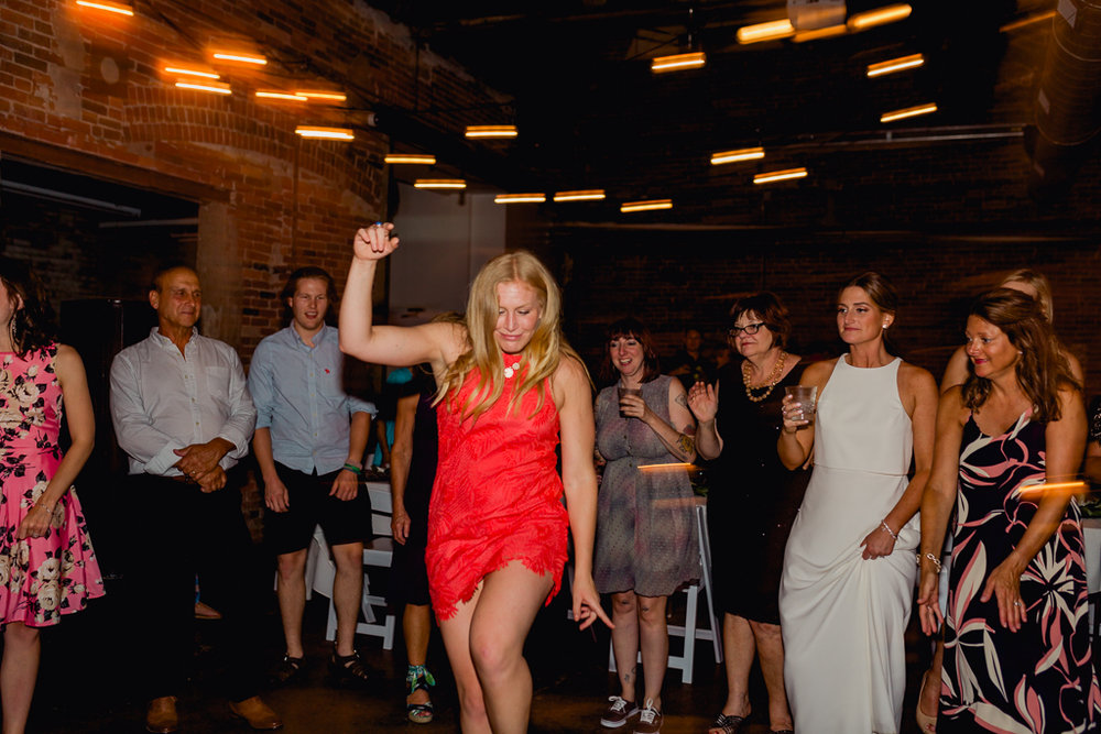 wild-dancing-guests-having-fun-strongwater-reception-columbus-ohio-wedding-photographer4.jpg