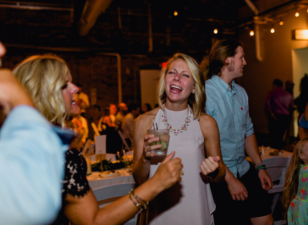 wild-dancing-guests-having-fun-strongwater-reception-columbus-ohio-wedding-photographer6.jpg