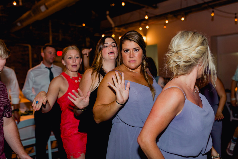 wild-dancing-guests-having-fun-strongwater-reception-columbus-ohio-wedding-photographer7.jpg
