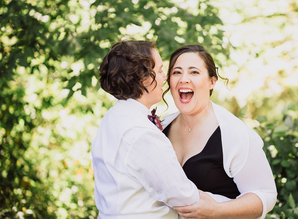 two-brides-happy-smiling-portrait-fall-wedding-outdoors-highbanks-metro-park-LGBT-photographer-columbus-ohio3.jpg