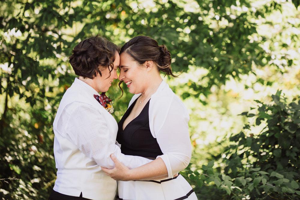 two-brides-happy-smiling-portrait-fall-wedding-outdoors-highbanks-metro-park-LGBT-photographer-columbus-ohio4.jpg