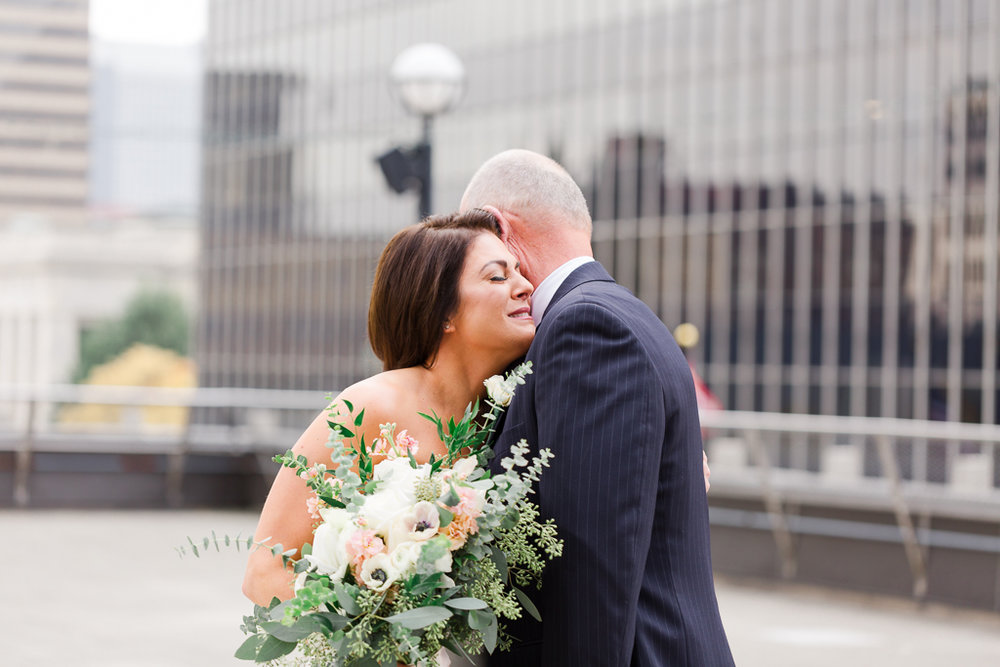 Bride cries after first look with her dad on the rooftop of the  Radisson Downtown Hotel  in Columbus OH before her wedding at  Via Vecchia .