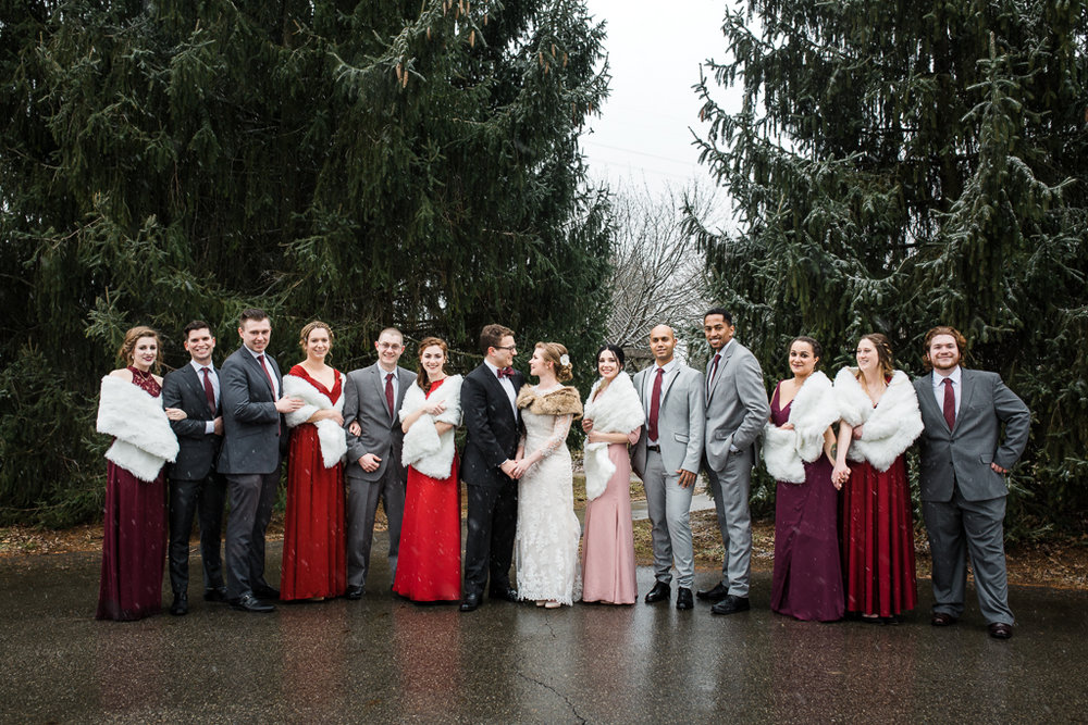 Large bridal party portrait in winter at Homestead park before wedding at Watersedge in Hilliard OH