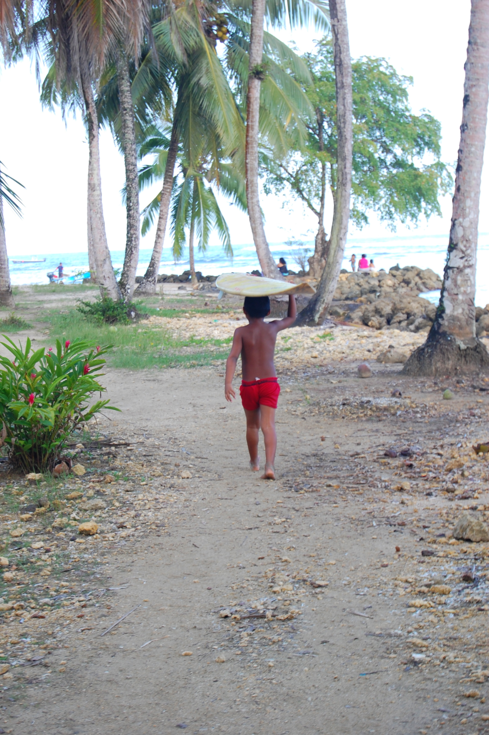 The kids in Bocas seem to learn to walk, then learn to surf- or maybe it's the other way around.