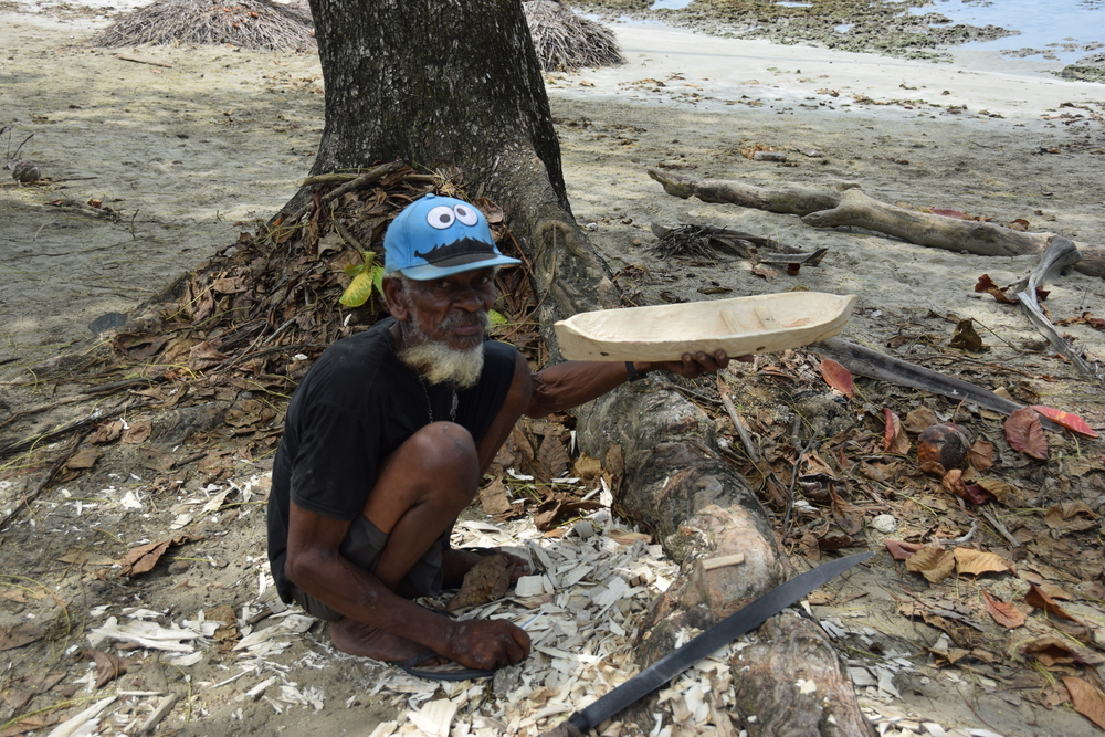 I ran into this Costa Rican guy carving a canoe on the beach. He was very excited to show off his craftmanship