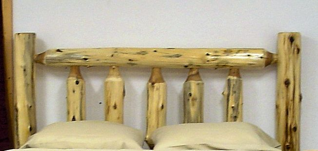cedar log headboard.jpg
