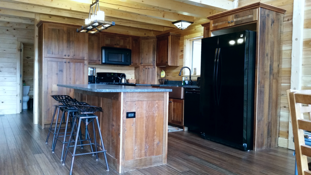 Completely Custom Barn Wood Kitchen Cabinets made from Reclaimed Barn Wood - in Heart Pine and Douglas fir woods. Contact us to design your custom kitchen cabinets today! 888-625-7570