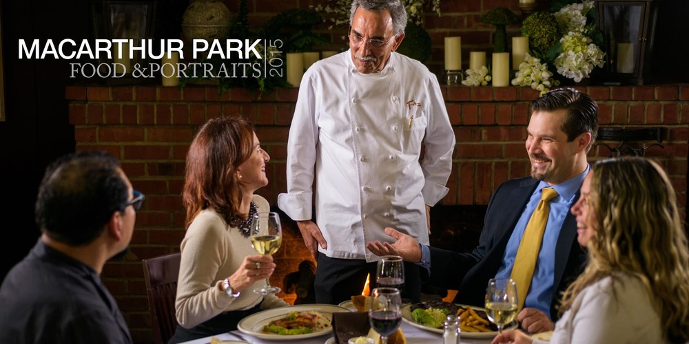 Table Touch –Chef greeting happy customers dining near the fireplace table