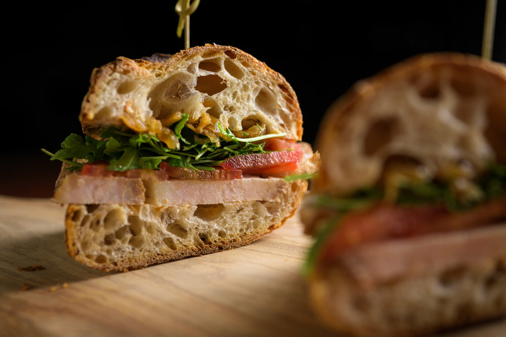 Sandwich on a wooden cutting board - Cupertino food photography - RootStock Wine Bar - photos by Bay Area commercial photographer Chris Schmauch
