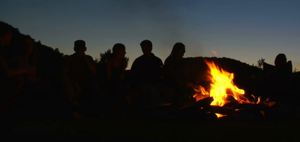 group-sits-around-campfire-at-dusk_z1s7lxgbb__F0000.png