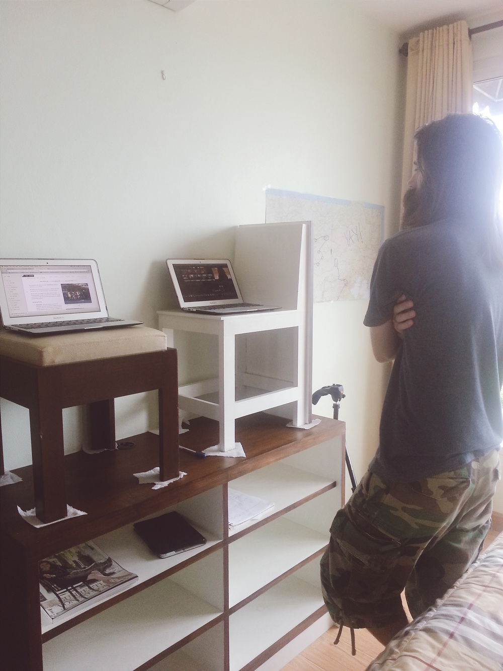 Yes, we made our own ergonomic standing workstations out of a stool and a chair we had in the apartment. Our landlord follows us on here (Hi Yuthapong!) so the paper towel legs are to show him we're taking care of the place, and that we are committed to getting our security deposit back! :) #TravelGlamlife