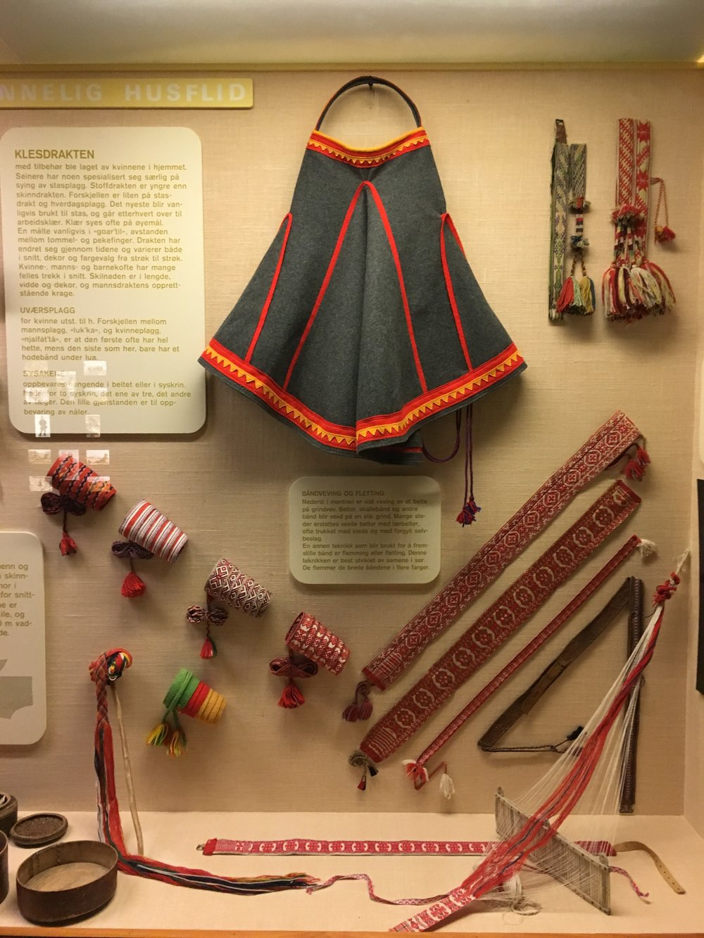 A Sami ceremonial skirt and hand woven belts.
