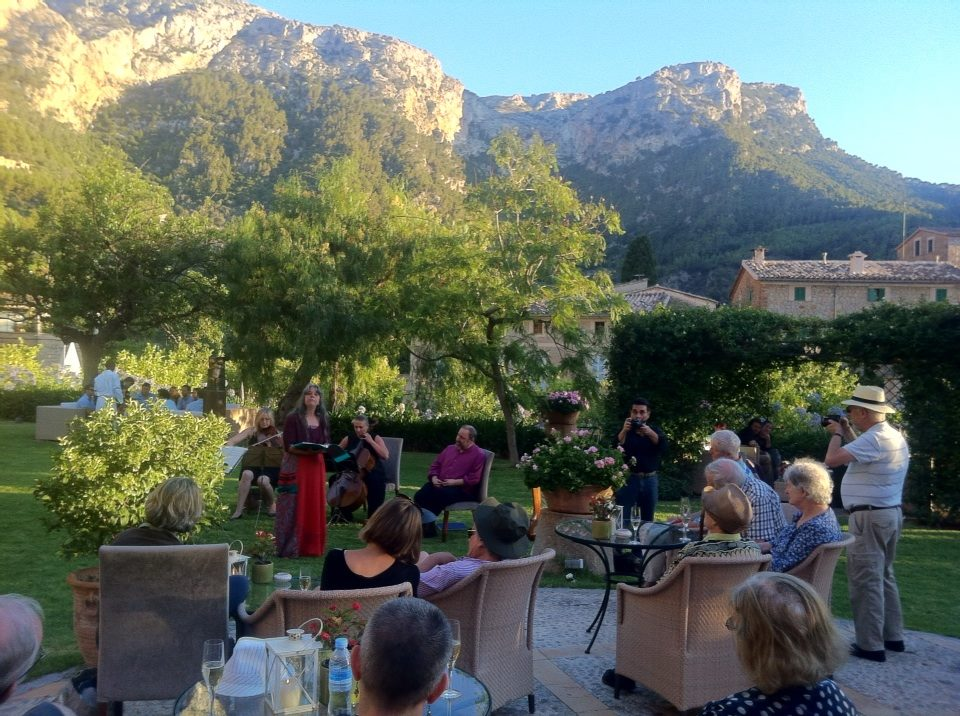 With Anne Hills performing in Deia, Mallorca with a string quartet. With the Tramuntana mountain range in the background. July 2014.