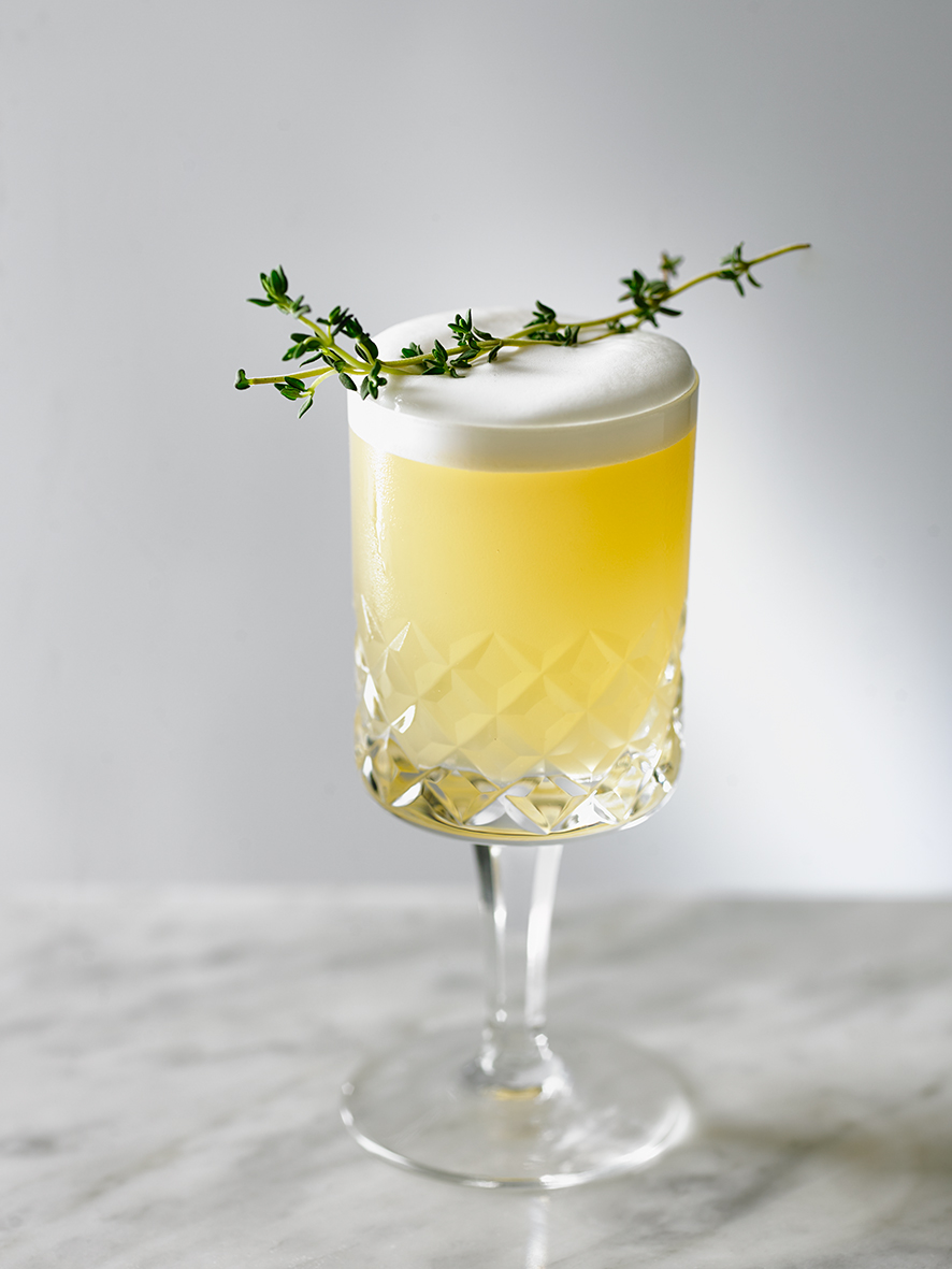 GODFATHER SOUR Buffalo Trace bourbon, amaretto, lemon, thyme, egg