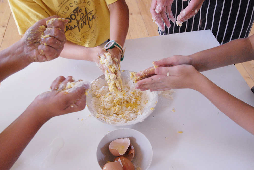 Making pasta is a pretty labourious activity for most chefs and the finished product is often dependent on the right temperature and timing. Of course, with a bunch of kids, success is mostly measured by how much you can squeeze stuff in your hands and pretend it's slime. Victory!