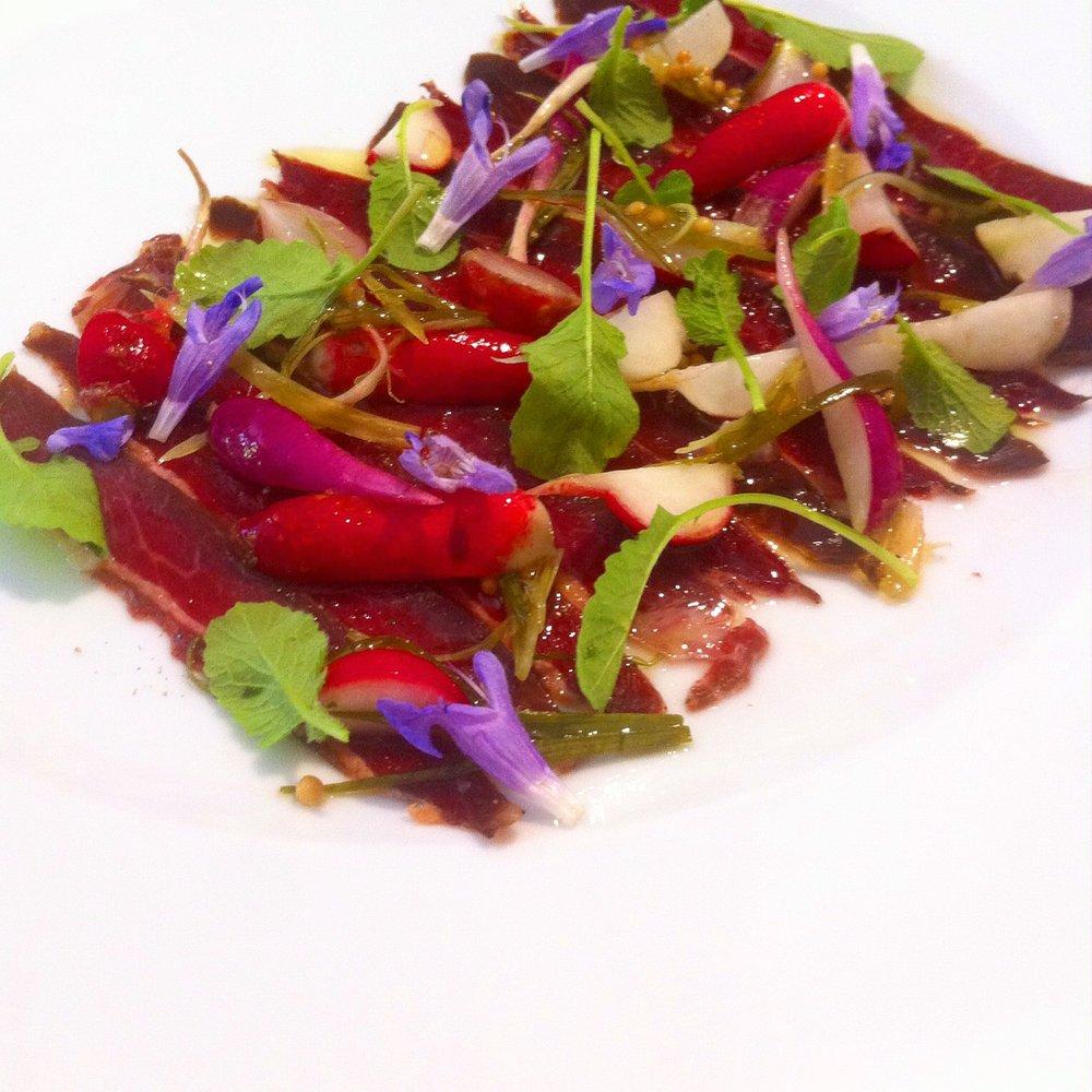 beef carpaccio, radish, rosemary flowers, mustard leaf