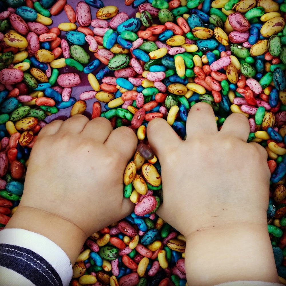 Ensure hands are 100% dry before playing with the beans, otherwise things can get a little messy!  BUT, it's only food colouring and it does wash off your hands fairly easily anyway. ;)
