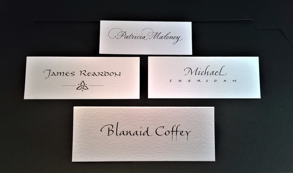 Place card styles. Clockwise from top, Copperplate, Italic, Roundhand, and Irish