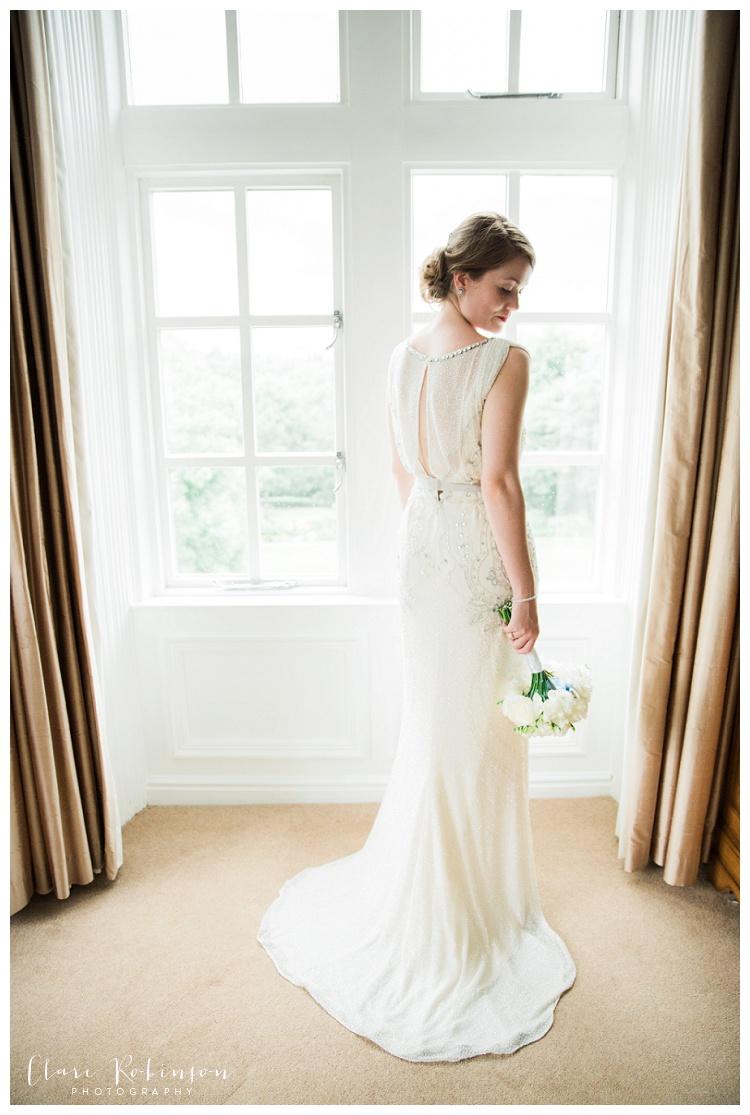 full length window portrait of bride