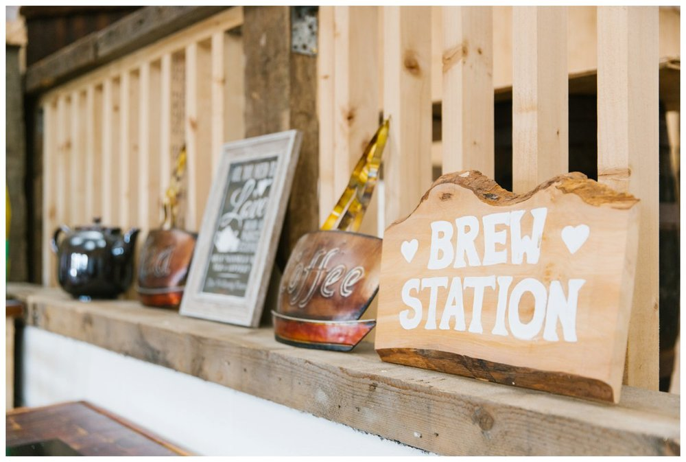 a hand painted 'brew station' plaque, along with some other tea and coffee metal signs