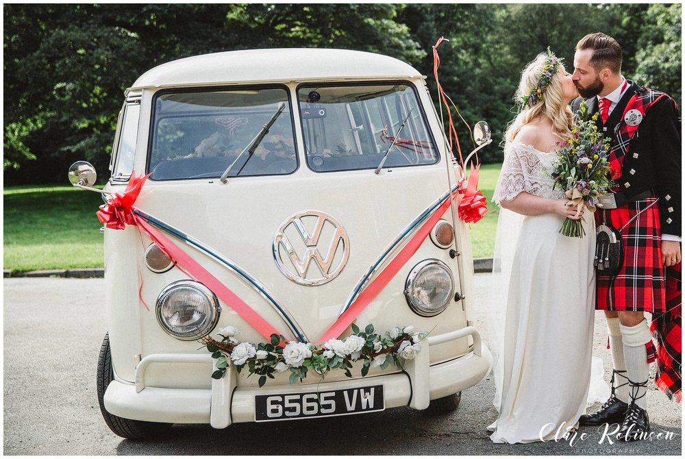 Bride and groom stood with VW camper van after just pulling up outside Rivington Hall Barn - Wedding photographer manchester