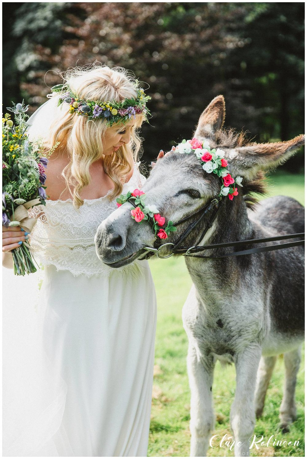Bride looking and stroking donkey on the lawn at Rivington Barn - Lancashire wedding photographer