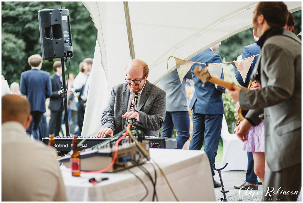 Musicians playing live music at festival inspired Rivington Barn Wedding - Creative wedding photography Lancashire