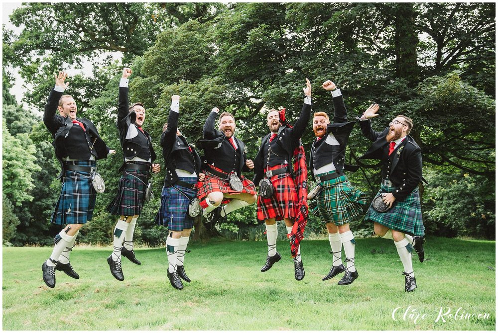 The groomsmen in kilts leaping in to the air - creative wedding photographer lancashire
