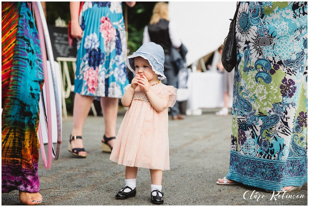 Little girl stood eating a strawberry  - Lancashire wedding photographer