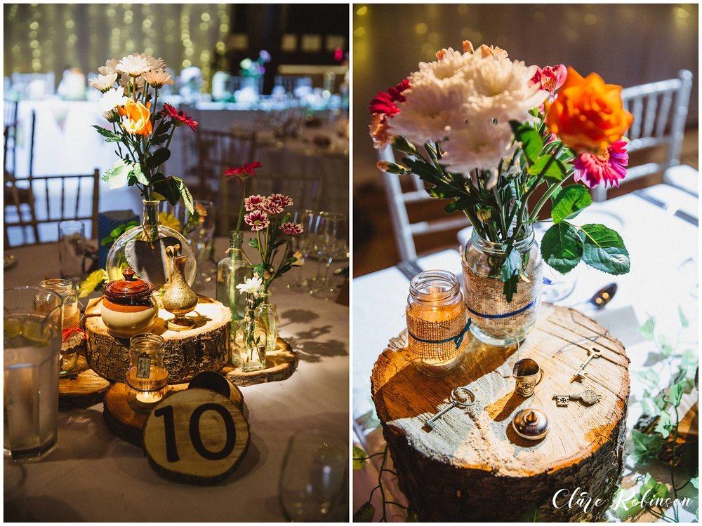 rustic wildflower and brass trinket centrepieces sat on a slice of wood - Lancashire wedding Photographer