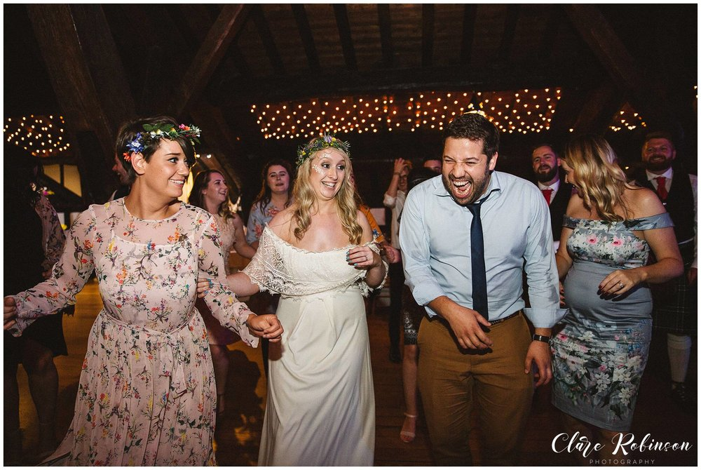 Bride and guests dancing to ceilidh band at boho wedding - Lancashire wedding photographer