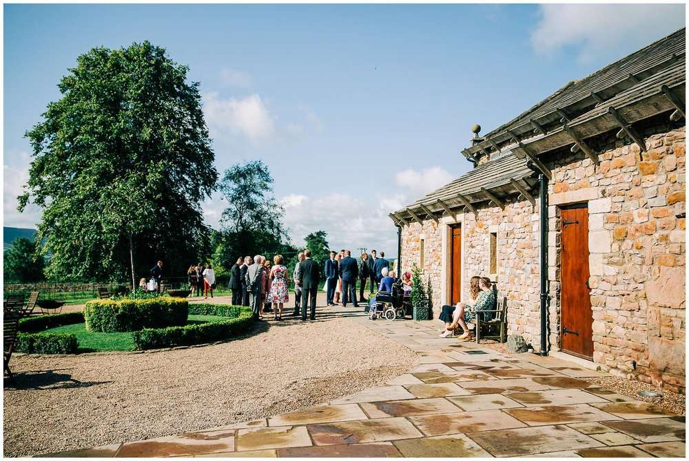guests arriving for a wedding at browsholme tithe barn