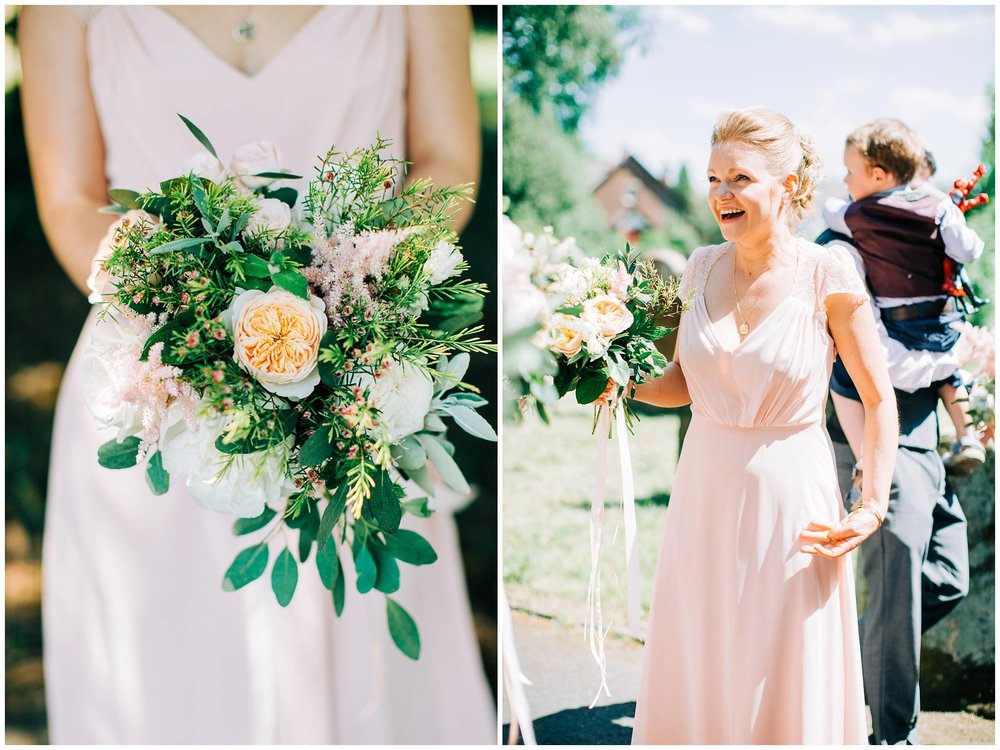 arriving bridesmaid laughing when arriving and holding her rustic bouquet