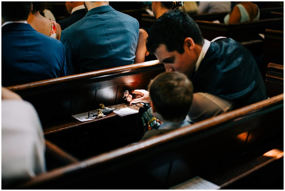 young guest playing with a toy dinosaur in the church