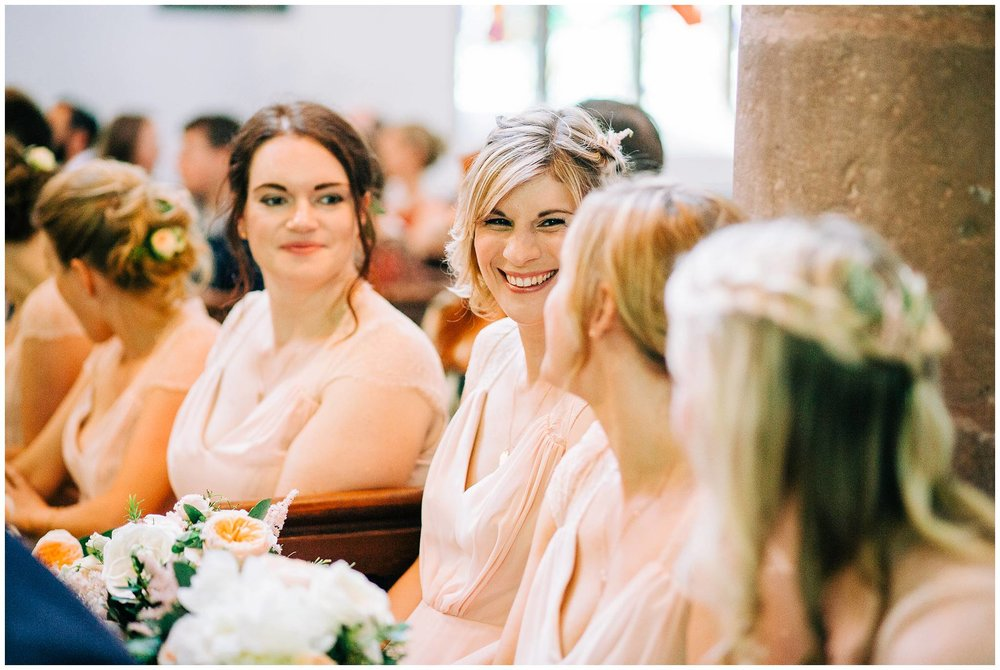 bridesmaid looking at each other and smiling