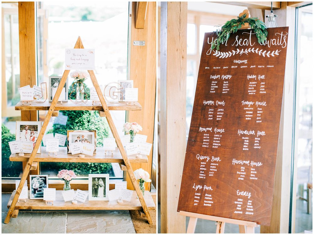 ladder sheving display with family photographs and a wooden seating plan with white calligraphy