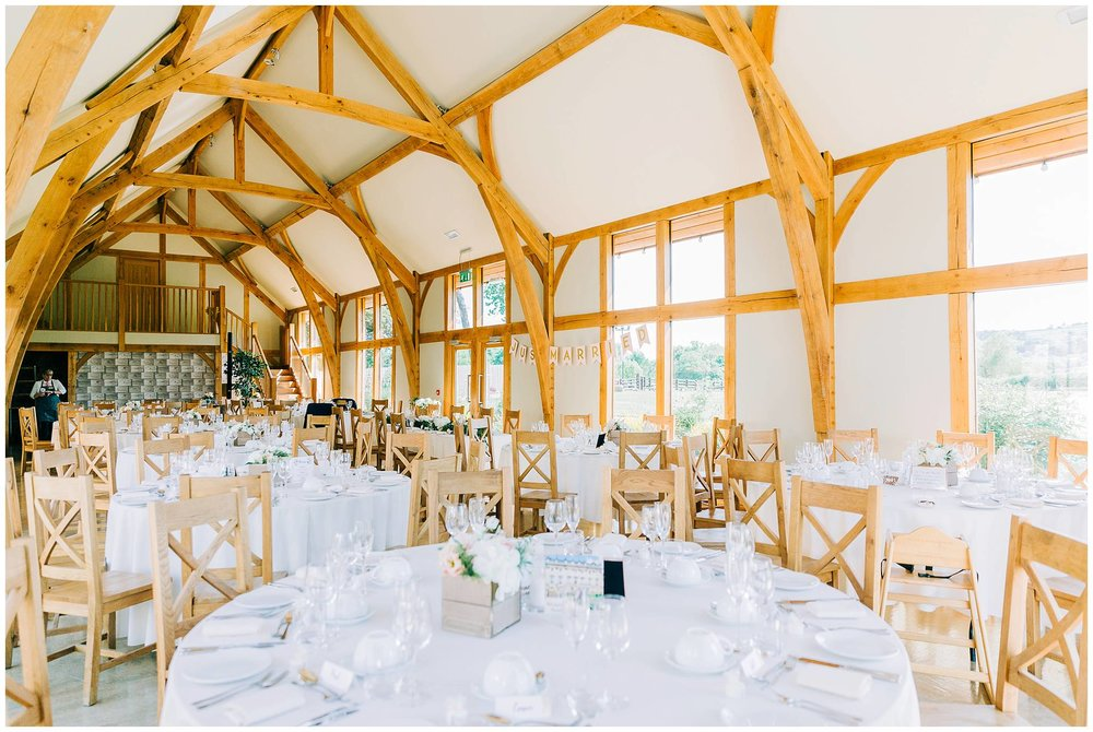 inside the wedding reception room where all the tables are laid beautifully