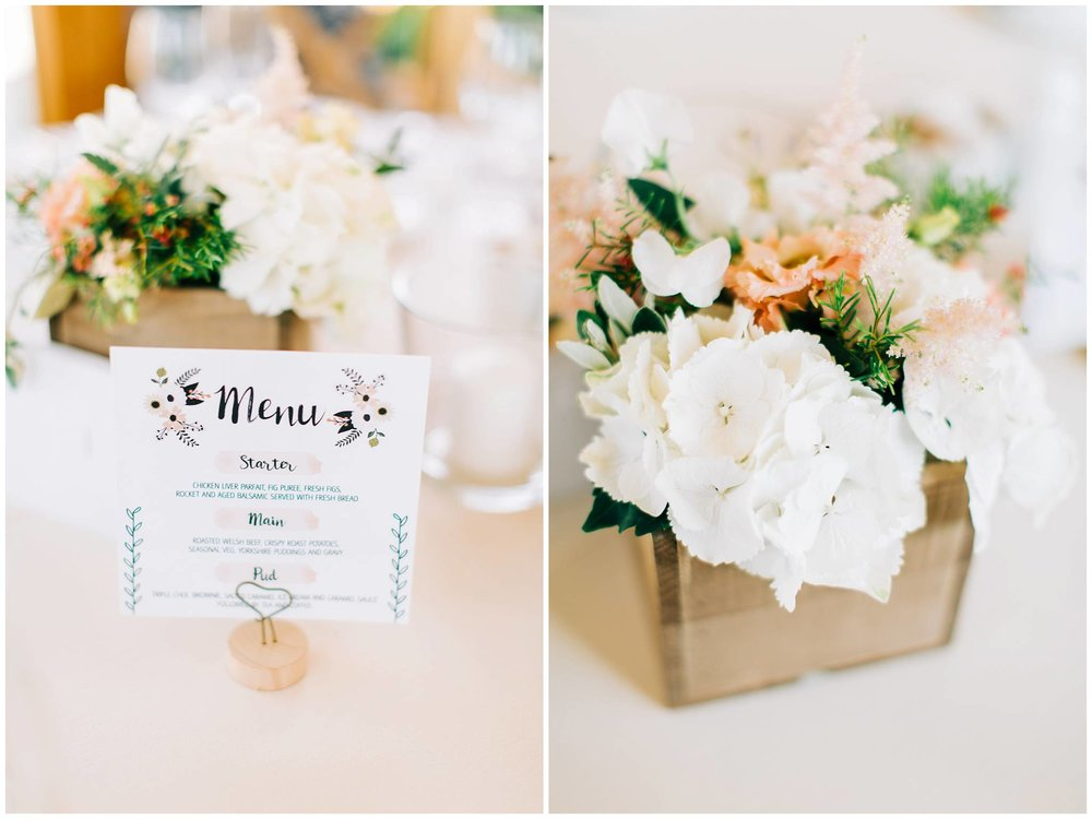 close up of the wedding breakfast menu and the floral centerpieces
