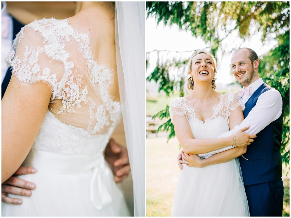 the bride and groom cuddling whilst laughing together and detail of the brides lace wedding dress on her shoulder