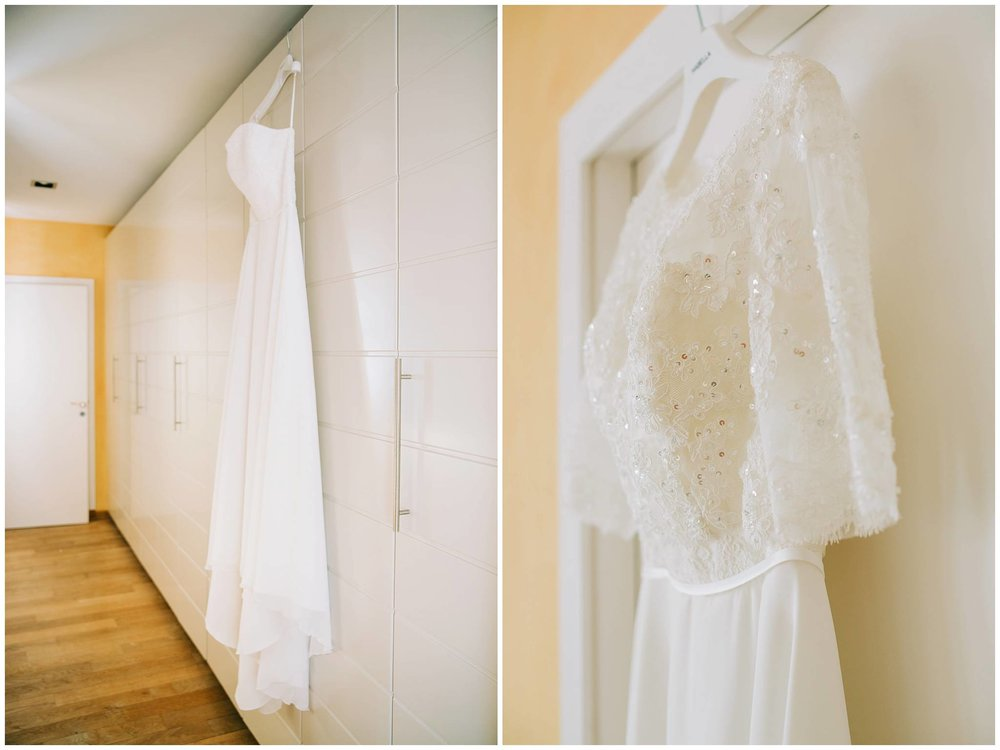 wedding dress hanging on wardrobe and close up detail of lace
