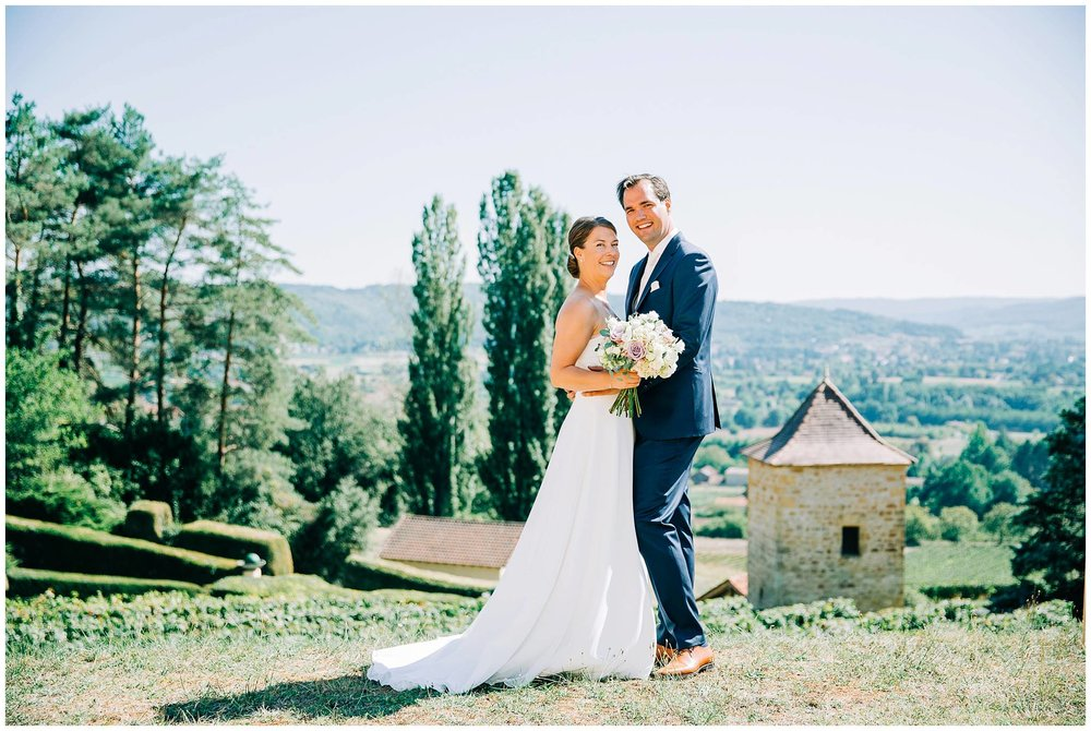 bride and groom stood overlooking cahors valley in the south of france