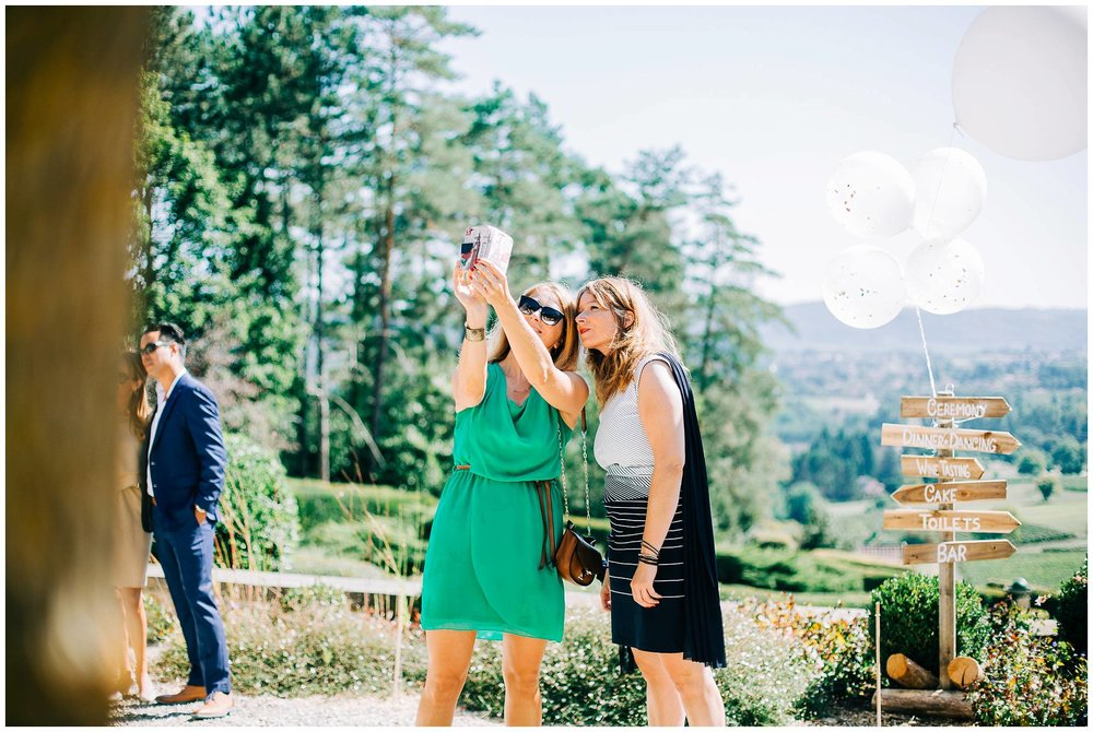 weddings guests taking selfies with gorgeous valley views in the background