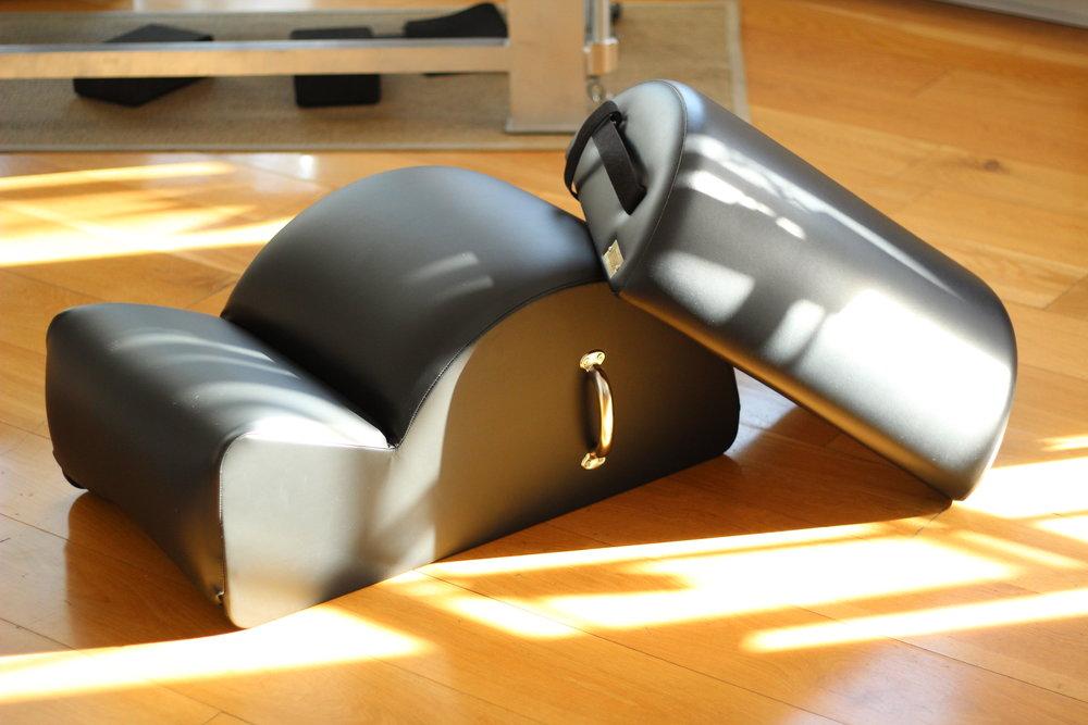 Spine corrector by Pilates scandinavia & small barrel by gratz Pilates equipment