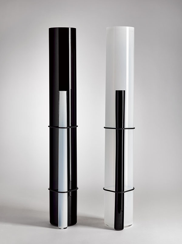 This series of white and black hand-blown cylindrical glass vases was designed by  Pierre Charpin  and created with the assistance of the  Centre International de Recherche sur le Verre et les Arts Plastiques  (CIRVA) in Marseille.