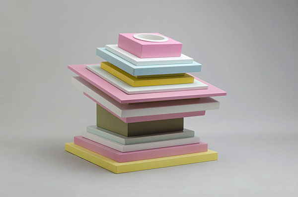 Geology  was designed by  Ettore Sottsass Jr  and manufactured by  Alessio Sarri Ceramiche  in 2000. The sculptured vase is composed of 15 individual layers of boxes of different sizes, in nine different matt glazes, and with an inner container for flowers in white porcelain.