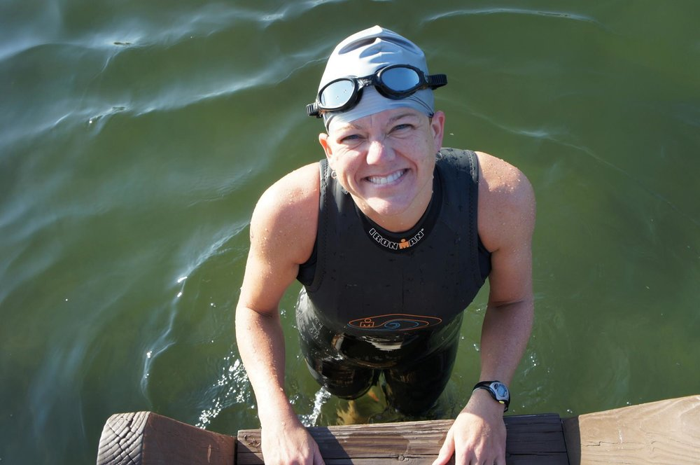 BETH ANDREW: Writer. planner. IRONMAN TRIATHLETE. Coach. Pilates nerd. Daughter. Sister. Wife. Aunt. Friend. Motivator. Relator. Competitor.  AKA, ALLSPICE: DUCHESS OF SPICELAND.  My mother-in-law is right: I'm addicted to triathlon. There. I said it. I love it. I can't live without it. I can't quit whenever I want to. All the signs are there! I want to swim, bike and run. And when I'm not doing it, I'm thinking about it, or reading about it or writing about it. Or, I'm coaching others who may or may not be addicted also.  I started triathlon 10 years ago with an all-women's sprint tri was immediately hooked. Last year, I completed my 50th triathlon! That includes 20+ sprints, about a dozen halfs and internationals and six iron-distance races.  I'm a Level II - Endurance Coach for USA Triathlon (one of three in NC), a SPINNING and pilates instructor for New Hanover Regional Medical Center's employee fit center and the cycling and running coach for Wilmington's YDubTriClub. I currently live in Wilmington, NC with my husband, Ace and our Boykin Spaniel, Sunny Day.