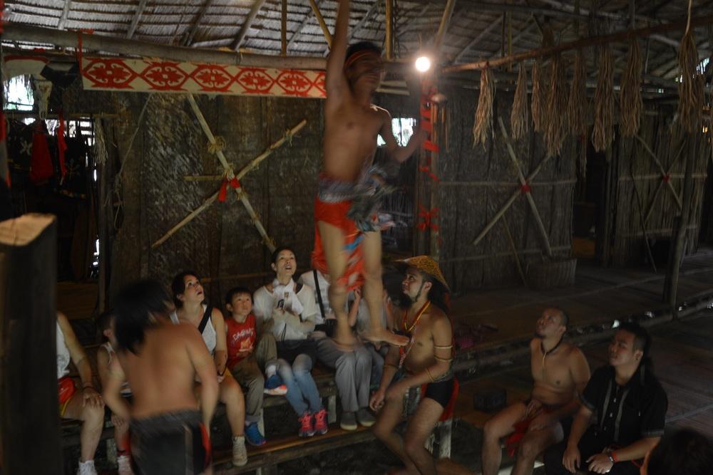 Indoor trampoline hut traditional dance demostration