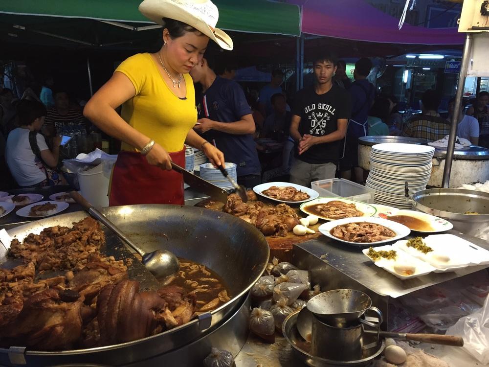 Pork and cowboy hats at the Chang Puak Gate market.